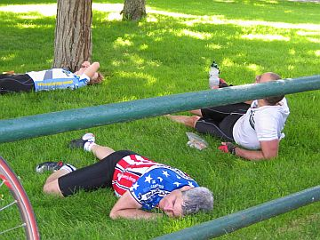 Riders laying on the grass